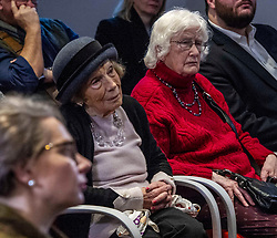 Pictured: 89 year old Mary Ross  (hat) has seen it all before and was interested in all opinions<br />