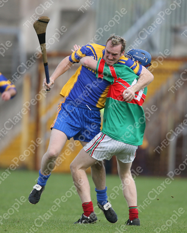 Brian Shally puts pressure on Alan |McNamara during the Clare County Hurling Intermediate final between Clooney/Quin and Killanena at Cusack park on Sunday.<br /> Photograph by Eamon Ward