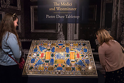 "© Licensed to London News Pictures. 28/06/2018. LONDON, UK. Visitors view ""The Grand Duke Francesco I De Medici table top 'Il Tavolino Di Gioie'"", 1568-77, by Bernardino Porfrio da Leccio.  Members of the public visit Masterpiece London, the world's leading cross-collecting art fair held in the grounds of the Royal Hospital Chelsea.  The fair brings together 160 international exhibitors presenting works from antiquity to the present day and runs 28 June to 4 July 2018.  Photo credit: Stephen Chung/LNP"
