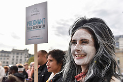 "© Licensed to London News Pictures. 31/10/2017. London, UK.  Women, many dressed up in 'mummy' costumes, take part in a ""March of the Mummies"", marching from Trafalgar Square to Parliament Square to demand recognition, respect and change for working mothers.  Photo credit: Stephen Chung/LNP"