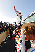 World Moto GP Championship.<br /> Round16.Phillip Island.Australia.Sunday16.10.2011.<br /> #27 Casey STONER (AUS) Repsol Honda Team.<br /> Wins the race and is crowned the 2011 Moto GP Champion on his 26th birthday.<br /> Here celebrating as Simoncelli walks by.<br /> © ATP Photo/ Damir IVKA<br /> Motorrad-WM - MotoGP in Australien - Motorrad - Moto GP -Motorradsport - Grand Prix in Phillip Island - Motorcycle racing in Australia - Moto2 - 16.10.2011 - <br /> - fee liable image - Photo Credit: © ATP / Damir IVKA