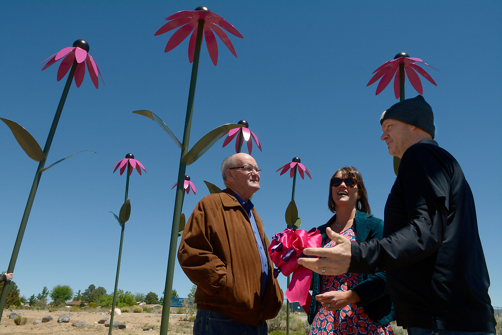 "gbs043017i/RIO-WEST -- Vincent Murphy, Deputy County Manager, Nan Masland, Public Art Project Coordinator, and Bernalillo County Commissioner Lonnie Talbert  visit at the Paradise Hills Community Center after the dedication of the public art sculptures titled ""Coneflowers"" by Colorado Springs artist Christopher Weed on Sunday, April 30, 2017. The artwork is funded by Bernalillo county 1% for the Arts.(Greg Sorber/Albuquerque Journal)"