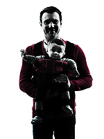 one man fathers parents with baby carrier portrait in silhouettes on white background