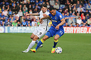 AFC Wimbledon defender Darius Charles (32) battles for possession with Northampton Town forward Marc Richards (9) during the EFL Sky Bet League 1 match between AFC Wimbledon and Northampton Town at the Cherry Red Records Stadium, Kingston, England on 11 March 2017. Photo by Matthew Redman.
