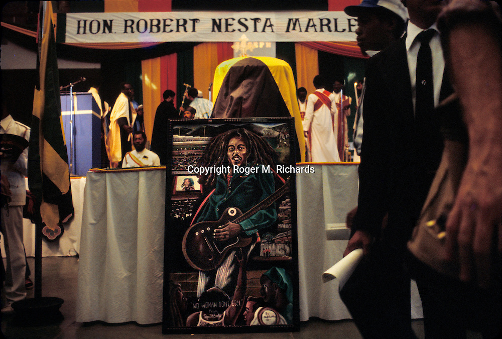 A painting of Reggae superstar Bob Marley lies propped up on a stage below the late singer's casket at the National Arena in Kingston, Jamaica, May 1981. Bob Marley died of cancer in a Miami hospital at the age of 36 on May 11, 1981. (Photo by Roger M. Richards)