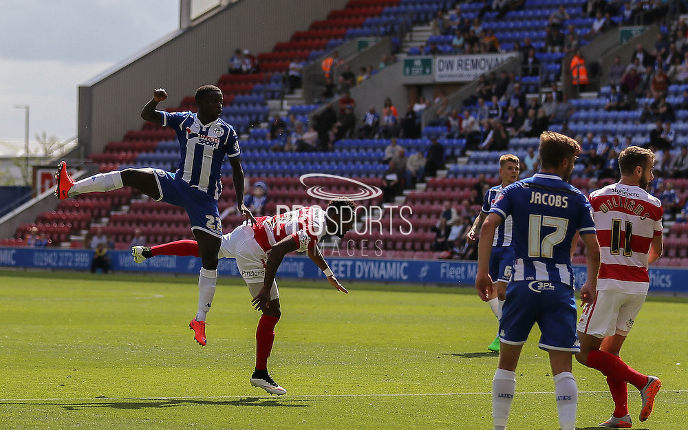 Francisco Júnior climbs high during the Sky Bet League 1 match between Wigan Athletic and Doncaster Rovers at the DW Stadium, Wigan, England on 16 August 2015. Photo by Simon Davies.
