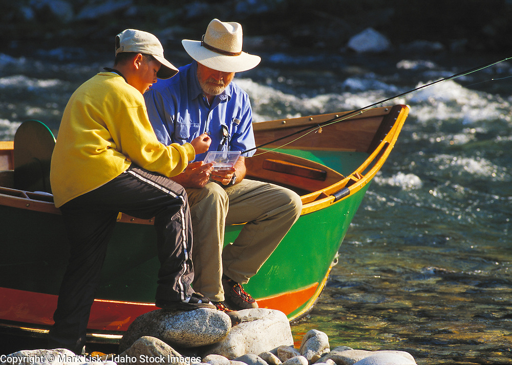 (MR) A grandfater and son pick flys for the day of fishingahead them on the Middle Fork of the Salmon River.