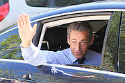 15.JULY.2011. FRANCE<br /> <br /> NICOLAS SARKOZY WAVING AT CTIZENS FROM HIS CAR ON VACATION IN WIFE CARLA BRUNI-SARKOZY IN BREGANCON, FRANCE<br /> <br /> BYLINE: EDBIMAGEARCHIVE.COM<br /> <br /> *THIS IMAGE IS STRICTLY FOR UK NEWSPAPERS AND MAGAZINES ONLY*<br /> *FOR WORLD WIDE SALES AND WEB USE PLEASE CONTACT EDBIMAGEARCHIVE - 0208 954 5968*