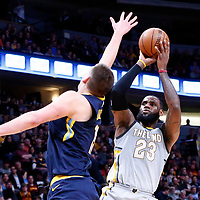 07 March 2018: Cleveland Cavaliers forward LeBron James (23) takes a jump shot over Denver Nuggets center Nikola Jokic (15) during the Cleveland Cavaliers 113-108 victory over the Denver Nuggets, at the Pepsi Center, Denver, Colorado, USA.