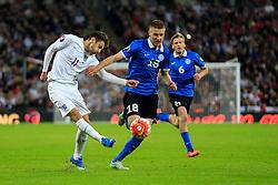 Adam Lallana of England passes under pressure from Taijo Teniste of Estonia - Mandatory byline: Jason Brown/JMP - 07966 386802 - 09/10/2015- FOOTBALL - Wembley Stadium - London, England - England v Estonia - Euro 2016 Qualifying - Group E