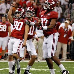 Jan 9, 2012; New Orleans, LA, USA; Alabama Crimson Tide kicker Jeremy Shelley (90) celebrates with teammates A.J. McCarron (10) and Chris Underwood (87) after kicking a field goal during the second half of the 2012 BCS National Championship game against the LSU Tigers at the Mercedes-Benz Superdome.  Mandatory Credit: Derick E. Hingle-US PRESSWIRE