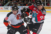 KELOWNA, CANADA - NOVEMBER 5:David Quenneville #19 of the Medicine Hat Tigers is checked by Conner Bruggen-Cate #20 of the Kelowna Rockets  on November 5, 2016 at Prospera Place in Kelowna, British Columbia, Canada.  (Photo by Marissa Baecker/Shoot the Breeze)  *** Local Caption ***