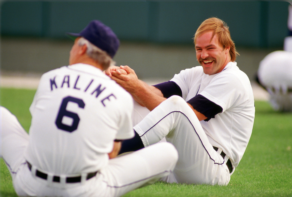 LAKELAND, FLORIDA - 1986:  Kirk Gibson laughs while talking to Al Kaline of the Detroit Tigers bats during a major league baseball spring training game at Joke Marchant Stadium in Lakeland, Florida prior to the 1986 season.  (Photo by Ron Vesely).  Subject:   Kirk Gibson; Al Kaline