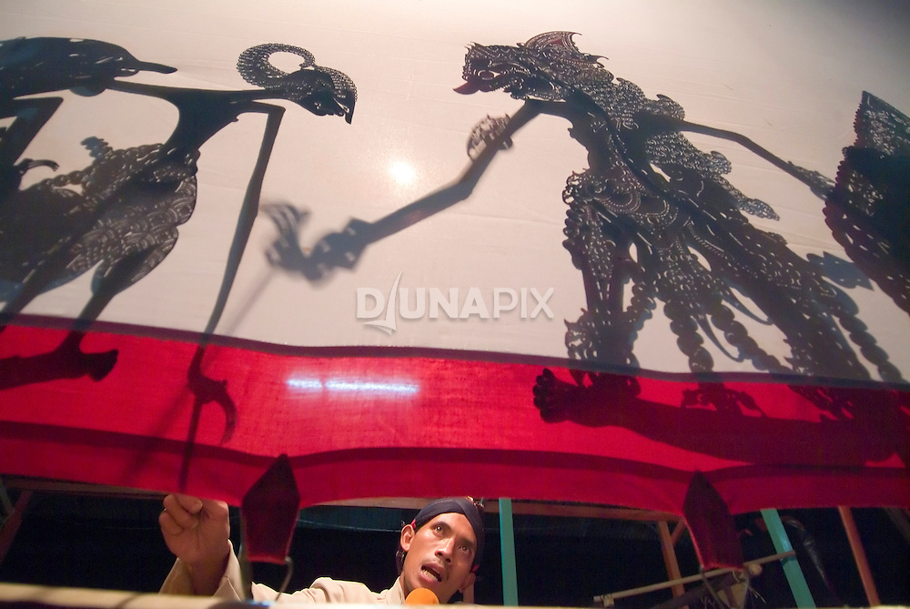 On 10 June 2006, villagers of Kinahredjo hosted a shadow puppet performance for fellow Merapi refugees--a show that pulled in more local viewers than the televised World Cup semi-finals. Here a dalang (puppeteer) pits an evil ogre against the noble hero Arjuna, out to save a world beseiged by woes. The contest was one of many trials in a 9pm to 5am performance (no intermissions!) which climaxed with Arjuna receiving the divine power needed to return the Earth to order. An ancient art, Javanese shadow theater commonly weaves modern dilemmas into a complex traditional tapestry.