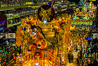 Floats in the Carnaval parade of GRES Sao Clemente samba school in the Sambadrome, Rio de Janeiro, Brazil.                The donkey is animatronic. Its head moves.