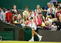 LONDON, ENGLAND - Thursday, June 28, 2012: Lukas Rosol (CZE) walks off centre court after beating Rafael Nadal (ESP) during the Gentlemen's Singles 2nd Round  match on day four of the Wimbledon Lawn Tennis Championships at the All England Lawn Tennis and Croquet Club. (Pic by David Rawcliffe/Propaganda)