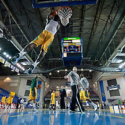 "George Mason 6'2"" Guard Vertrail Vaughns (11) dunks during warm-ups prior to a regular season NCAA basketball game against Delaware Saturday, March 2, 2013 at the Bob Carpenter Center in Newark Delaware."