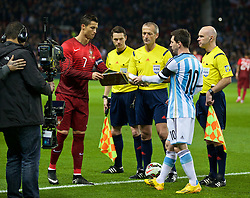 MANCHESTER, ENGLAND - Tuesday, November 18, 2014: Argentina's captain Lionel Messi and Portugal's captain Cristiano Ronaldo before the International Friendly match at Old Trafford. (Pic by David Rawcliffe/Propaganda)