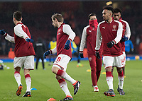 Football - 2017 / 2018 Premier League - Arsenal vs. Everton<br /> <br /> Pierre-Emerick Aubameyang (Arsenal FC) warms up ahead of kick off alongside his new team mates at The Emirates.<br /> <br /> COLORSPORT/DANIEL BEARHAM