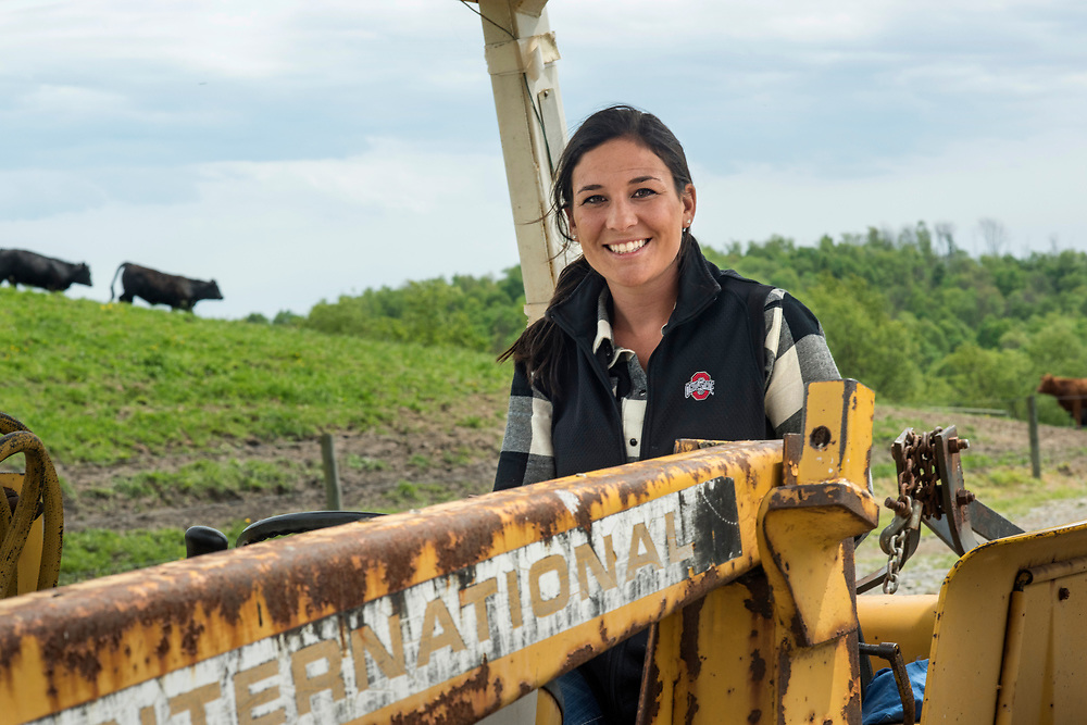 Carmichaels, PA, May 4, 2017:  Pro golfer Rachel Rohanna on the tractor they use to move feed for their beef cattle at Oak Hills Farm in Greene County, PA. ( Martha Rial for espnW)