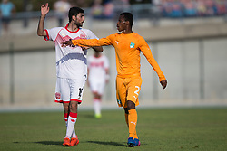 AUBAGNE, FRANCE - Tuesday, May 30, 2017: Ivory Coast's Alkhayyat Husain Abbas and Bahrain's Ali Alkarrani Hasan in action during the Toulon Tournament Group B match between Bahrain and Ivory Coast at the Stade de Lattre-de-Tassigny. (Pic by Laura Malkin/Propaganda)