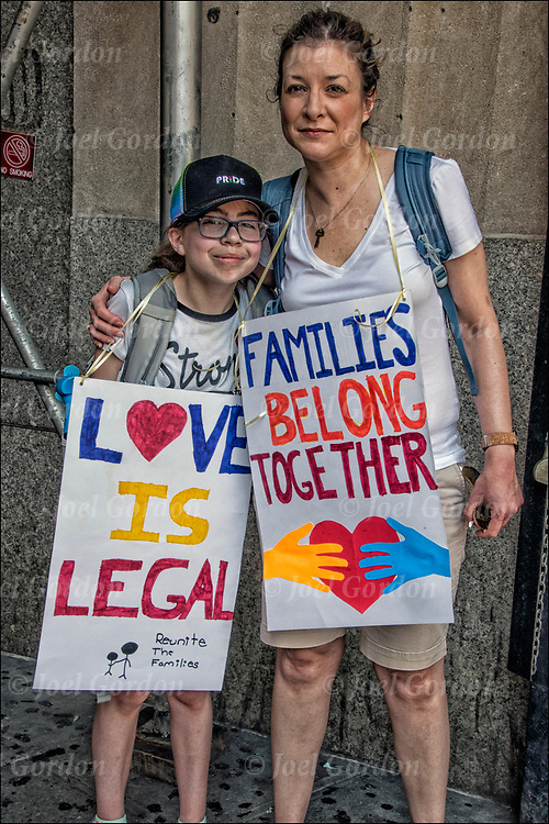 Mother and daughter protesters holding up signs &quot;Love Is Legal&quot; and &quot;Families Belong Together&quot;  @ Foley Square and then across the Brooklyn Bridge before rallying in Cadman Plaza.<br /> <br /> Thousands are gathering in Manhattan &mdash; in one of about 750 planned marches around the country &mdash; to protest the Trump administration&rsquo;s rescinded policy of separating immigrant children and parents suspected of illegally crossing the U.S. border. <br /> <br /> Demand an end to President Trump&rsquo;s cruel &ldquo;zero tolerance&rdquo; policy and to support immigrant families in New York and across the country.<br /> <br /> Every day, this administration threatens the very future of our communities. The conditions these children are being subjected to is deplorable and un-American.