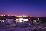 Residents of Susiya live in tents and caves without access to running water or electricity. The nearby illegal Israeli settlement has both in abundance.<br />