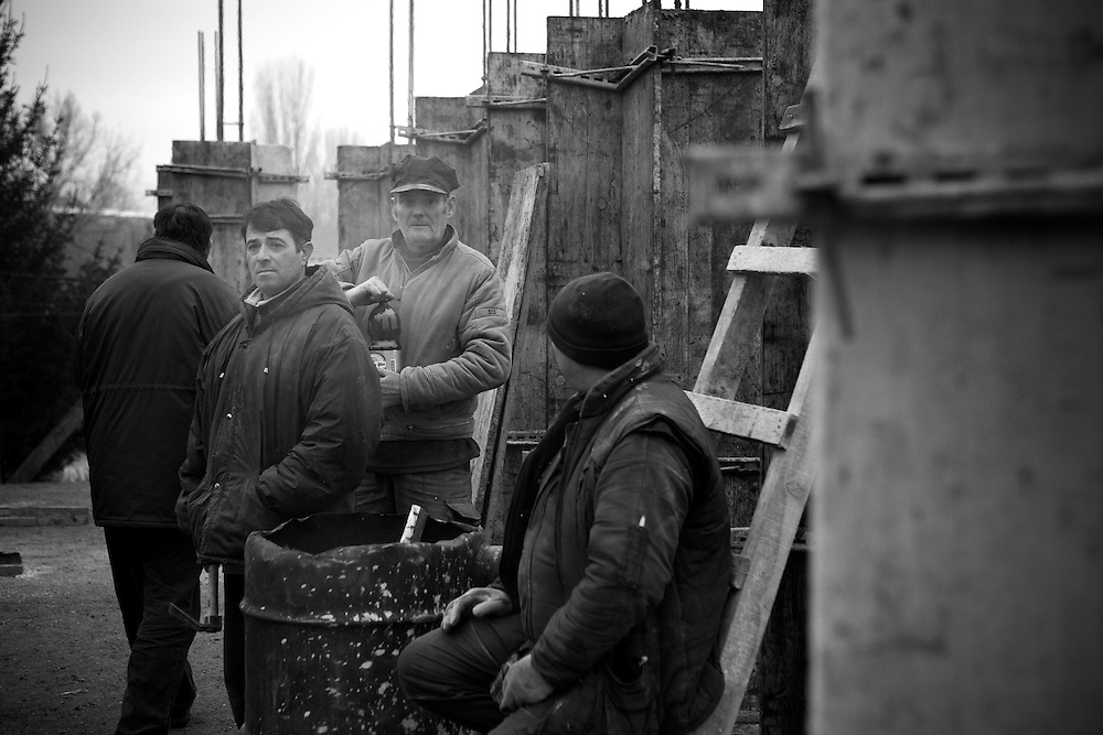 Serbian construction workers take a break from building apartment blocks in Serbian dominated north Mitrovica, Kosovo, on Dec, 30, 2007. In anticipation of a declaration of Independence from Pristina, Belgrade is seeking to consolidate the Serbian presence in the territory. (photo: Greg Funnell)