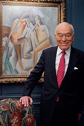 Leonard Lauder portrait in his apartment in NYC posing before his cubist collection. Photographed for The Cubist Catalogue for the Metropolitan Museum of Art Art Reproduction Photography Services