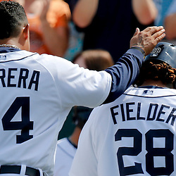 Feb 27, 2013; Lakeland, FL, USA; Detroit Tigers first baseman Prince Fielder (28) celebrates with third baseman Miguel Cabrera (24) after hitting a two run homerun during the bottom of the first inning of a spring training game against the Atlanta Braves at Joker Marchant Stadium. Mandatory Credit: Derick E. Hingle-USA TODAY Sports