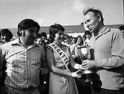Dingle Regatta.22/08/1976.08/22/1976.22nd August 1976.Dingle Regatta Queen, Miss Mary Moore, presenting the Guinness Cup to Murt O'Connell, Cahirciveen, Captain of the Winning team in Seine Boat Competition, which took place on Sunday, (22.8.76), Mr. Leo Brosnan,(left), Organiser and Secretary of Dingle Regatta Committee, also included in the picture.