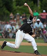 Roswell pitcher Austin Krzeminski throws to Milton in the sixth inning of their GHSA AAAAAA State Baseball Championship game at Milton High School, Monday, May 27, 2013, in Milton, Ga.   David Tulis / AJC Special