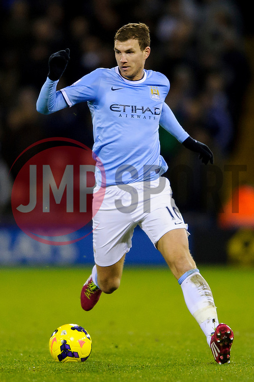 Man City Forward Edin Dzeko (BIH) in action during the first half of the match - Photo mandatory by-line: Rogan Thomson/JMP - Tel: Mobile: 07966 386802 - 04/12/2013 - SPORT - FOOTBALL - The Hawthorns Stadium - West Bromwich Albion v Manchester City - Barclays Premier League.