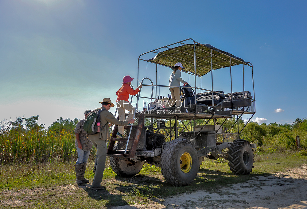 A family boards a swamp buggy for a tour of Big Cypress National Preserve in Florida, near Everglades National Park.