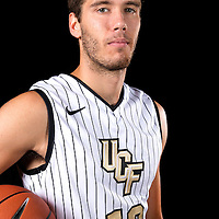 Guard Tyler Coons poses during the Knights media day event at the University of Central Florida CFE Arena on Monday, October 7, 2013 in Orlando, Florida. (AP Photo/Alex Menendez)