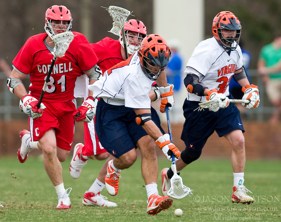 Virginia Cavaliers D Chad Gaudet (7) scoops up a loose ball in front of Cornell Big Red M Tommy Schmicker (31).  The #1 ranked Virginia Cavaliers defeated the #4 ranked Cornell Big Red 14-10 at Klockner Stadium on the Grounds of the University of Virginia in Charlottesville, VA on March 8, 2009.