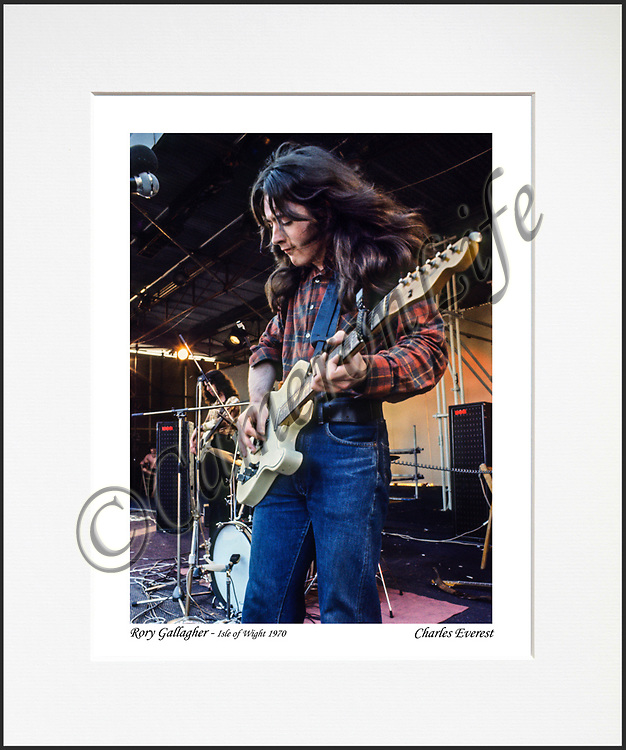 Rory Gallagher - An affordable archival quality matted print ready for framing at home.<br />  Ideal as a gift or for collectors to cherish, printed on Fuji Crystal Archive photographic paper set in a neutral mat (all mounting materials are acid free conservation grade). <br />  The image (approx 6&quot;x8&quot;) sits within a titled border. The outer dimensions of the mat are approx 10&quot;x12&quot;