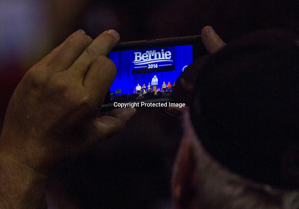 A supporter takes pictures during a rally for democratic presidential candidate Sen. Bernie Sanders, I-Vt., Monday, Aug. 10, 2015, at the Los Angeles Memorial Sports Arena in Los Angeles. (AP Photo/Ringo H.W. Chiu)