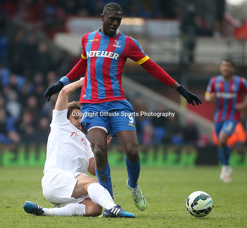 14 March 2015 - Barclays Premier League - Crystal Palace v Queens Park Rangers - Niko Kranjcar of QPR tackles Yaya Sanogo of Palace.<br /> <br /> Photo: Ryan Smyth/Offside