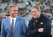 October 10, 2009: ESPN's Kirk Herbstreit and Iowa head coach Kirk Ferentz talk before the Iowa Hawkeyes' 30-28 win over the Michigan Wolverine's at Kinnick Stadium in Iowa City, Iowa on October 10, 2009.