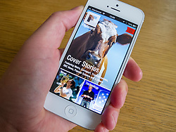 Flipboard social media app on white iPhone 5 smartphone