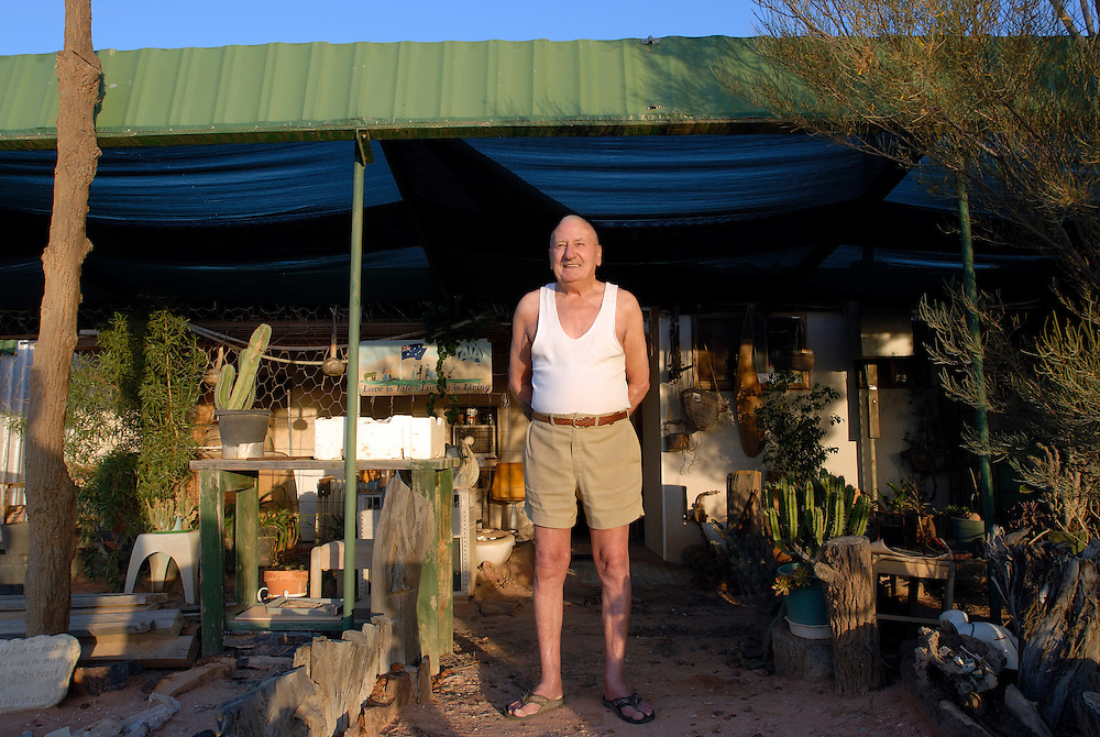 Jeff Mundenburg (Andamooka resident) in front of his home. South Australia.