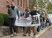 William D.R. McFarland, left, and William O. Arnold, right, led the Walk a Mile in Her Shoes event by leading the pack and initiating chants. Photo by Elizabeth Held