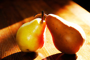Two pears on wooden table