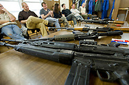 An array of machine guns sit on a classroom table during the Centurion HEFAT course in Virginia. Students, many of whom are journalists, are introduced to a variety of weapons and ballistics to better understand the risk involved in entering a hostile area. Firearm training for the Hostile Environments and Emeregency First Aid Training course for journalists deploying to war zones in Strausburg, VA. (Model Released)