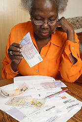 Black woman sorting out the bills.