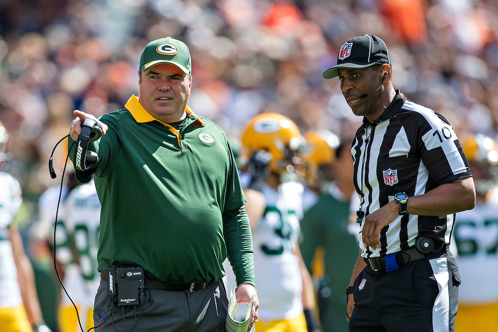 CHICAGO, IL - SEPTEMBER 13:  Head Coach Mike McCarthy of the Green Bay Packers talks with Field Judge Julian Mapp #10 during a game against the Chicago Bears at Soldier Field on September 13, 2015 in Chicago, Illinois.  The Packers defeated the Bears 31-23.  (Photo by Wesley Hitt/Getty Images) *** Local Caption *** Mike McCarthy; Julian Mapp