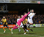 Cambridge United Goalkeeper Chris Dunn punches clear with Manchester United's Robin Van Persie closing in during the The FA Cup match between Cambridge United and Manchester United at the R Costings Abbey Stadium, Cambridge, England on 23 January 2015. Photo by Phil Duncan.