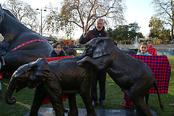 © Licensed to London News Pictures. 04/12/2019. London, UK. Parliamentary Conservative candidate for Richmond Park and North Kingston and former Tory candidate for Mayor of London ZAC GOLDSMITH speaks at unveiling of life-sized herd of 21 bronze elephants at Marble Arch.<br /> Children unveil a herd of 21 bronze elephants at Marble Arch. The sculpture is the largest such depictionof an elephant herd in the world and is intended to draw attention to the plight of this species that could be extinct on current trends, by 2040. Each elephant in the sculpture is modelled after a real orphaned animal currently in the care of the Sheldrick Wildlife Trust. Left behind by poachers and other sources of human-wildlife conflict these animals have been raised by the trust in an effort to secure the future of the species. The herd will be displayed until 4 December 2020. Photo credit: Dinendra Haria/LNP
