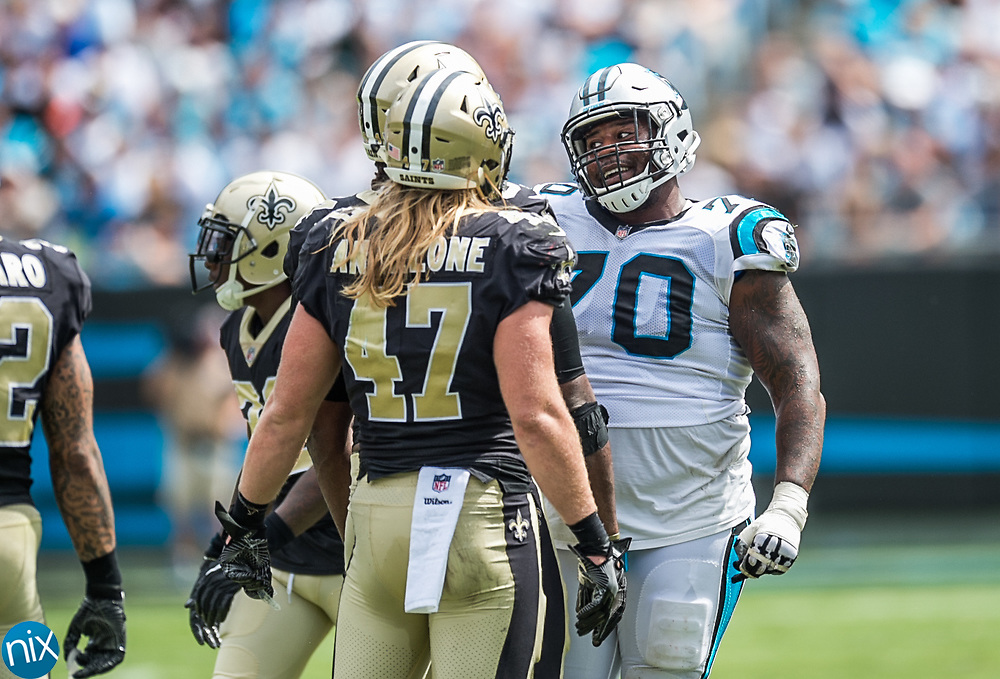 Carolina Panther Trai Turner (70) talks to New Orleans Saints defenders after a play at Bank of American Stadium on Sunday, September 24, 2017 in Charlotte, NC.